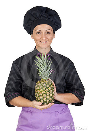Pretty cook woman with pineapple