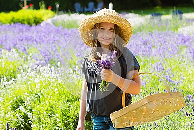Pretty country girl picking flowers