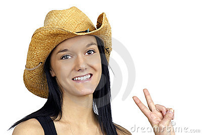 Pretty cowgirl making peace sign