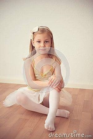 Free Pretty Diligent Ballet Girl Sitting In White Tutu At Dance Studi Stock Image - 78382491