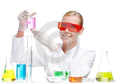 Pretty doctor hands a beaker
