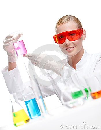 Pretty doctor in spectacles keeps a beaker