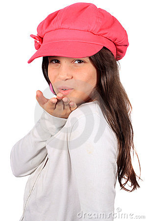 Pretty eight year old girl blowing kiss