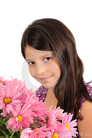 Pretty eight year old girl with flowers