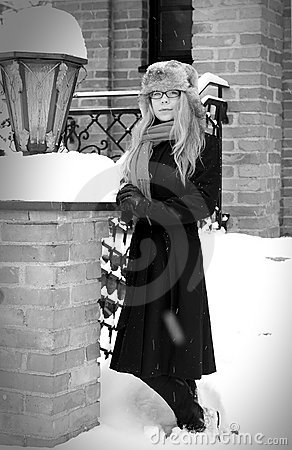 Pretty elegant woman in winter with snow