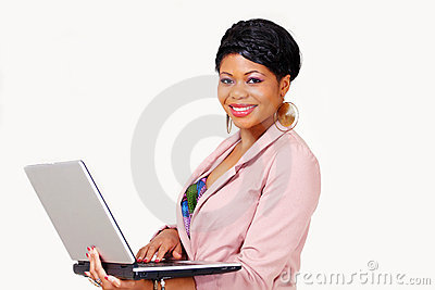 Pretty ethnic lady with laptop smiling