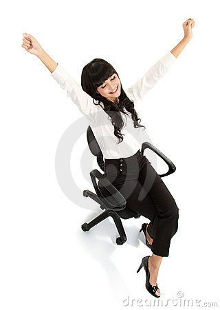 Pretty excited young woman sitting on chair