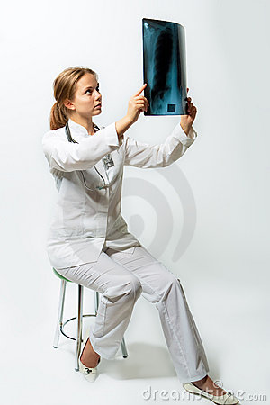 Pretty female blonde doctor with x-ray staring