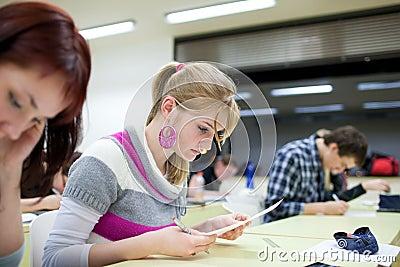Pretty female college student  in a classroom