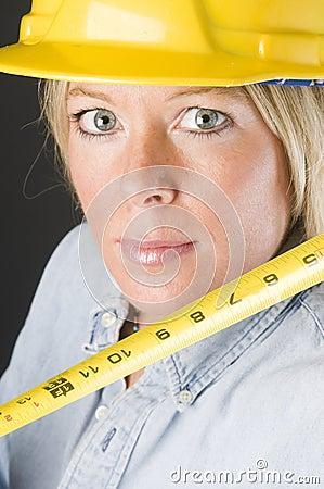 Pretty  female construction worker hard hat helmet