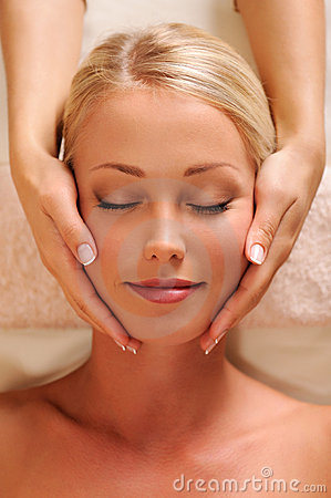 Pretty female face getting relaxation massage