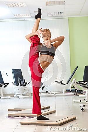 Pretty female gymnast posing