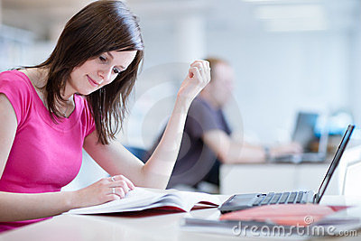 Pretty female student with laptop