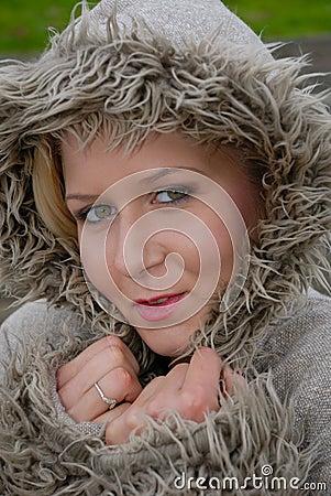 Pretty female in warm coat
