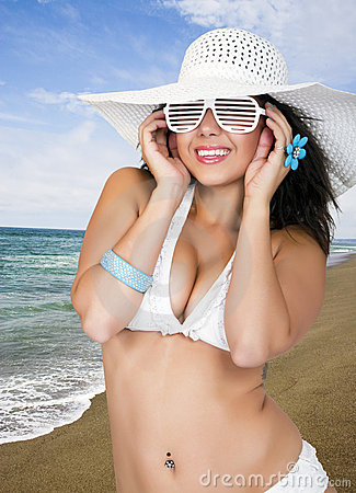 Pretty female wearing a bikini and sun hat