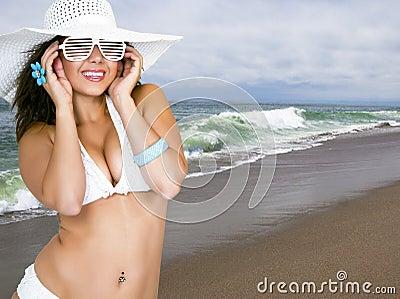 Pretty female wearing a bikini and sun hat