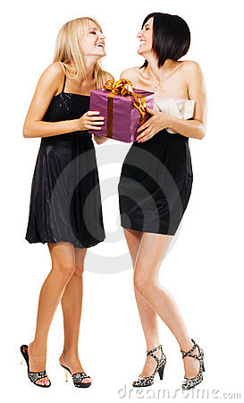Pretty festive girls with a gift box