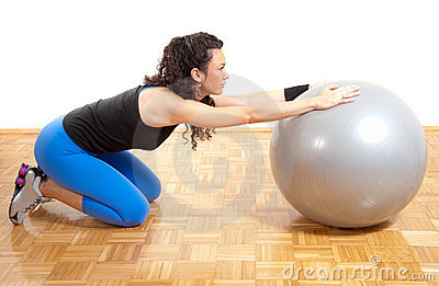 Pretty fitness girl with ball