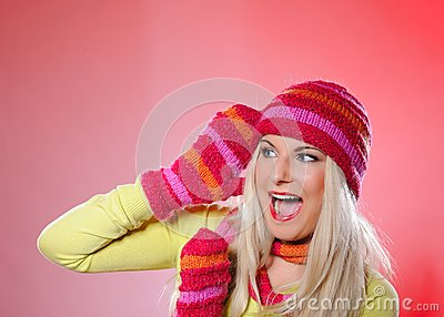 Pretty funny winter woman in hat and gloves scream