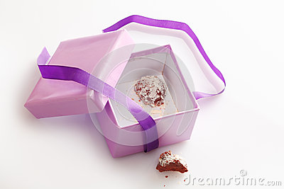 Pretty gift box with last chocolate truffle
