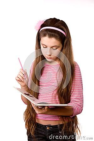 Pretty girl in the age of eleven reading book