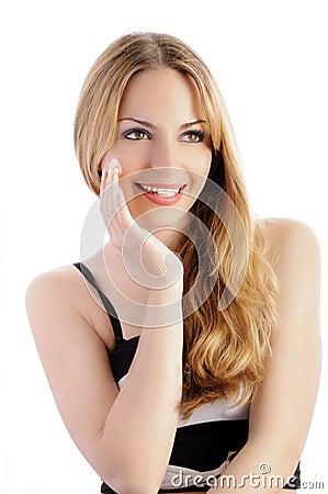 Pretty girl applying cream