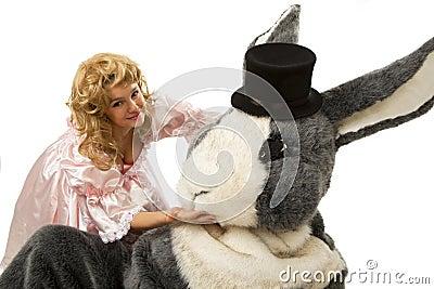 Pretty girl with a big grey rabbit