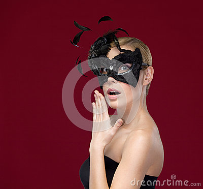 Pretty girl with black masquerade mask