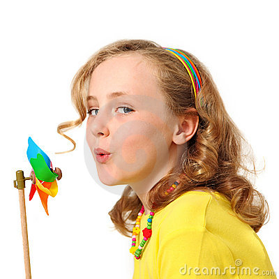 Pretty girl blowing windmill