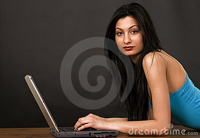 Pretty girl chatting on internet