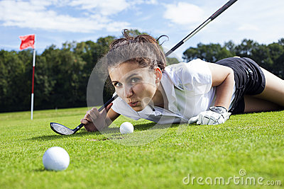 Pretty girl cheating on golf field
