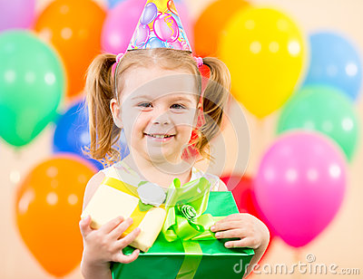 Pretty girl with colourful balloons and gift
