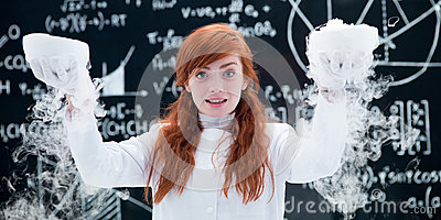 Pretty girl conducting a gas lab experiment