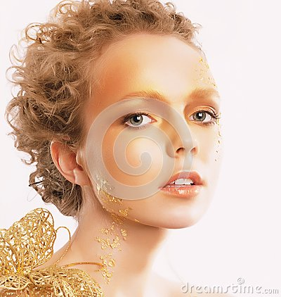 Styled Golden Woman s Face. Curly Hair. Professional Bronzed Makeup
