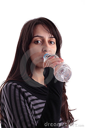 Pretty girl drinking water from a bottle