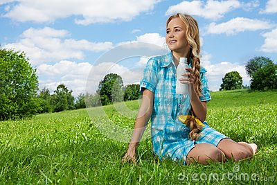 Pretty girl drinking yogurt