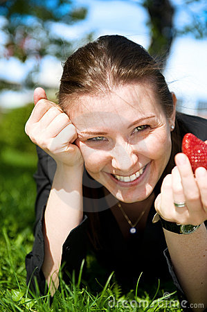 Free Pretty Girl Eat Red Frash Strawberry On Green Royalty Free Stock Photos - 5211278