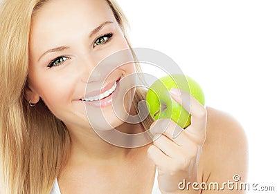 Pretty girl eating apple