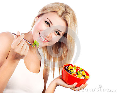 Pretty girl eating fruit salad