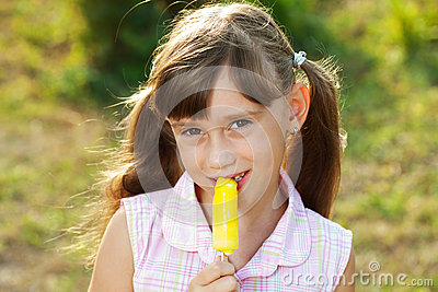 Pretty girl eating ice cream