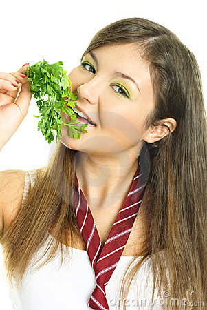 Pretty girl eating parsley