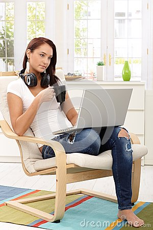 Pretty girl enjoying leisure time with laptop