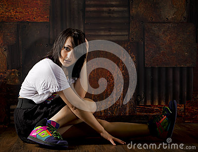 Pretty girl on floor with grunge background