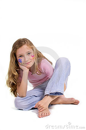 Pretty girl with flower butterfly make-up sitting on the floor