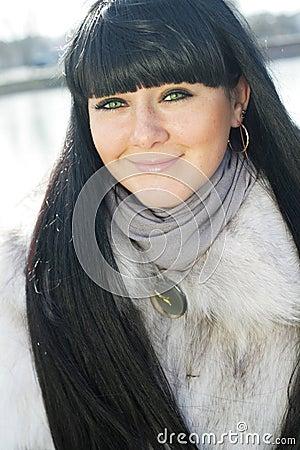 Pretty girl in fur coat