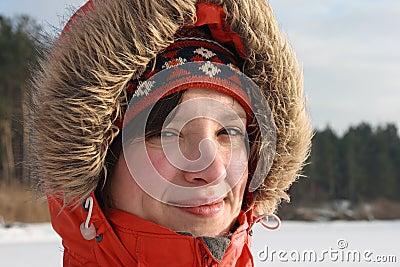 Pretty girl in fur hood. Winter day