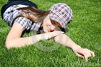Pretty girl on the green grass