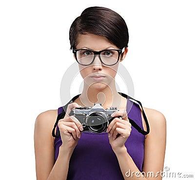 Pretty girl hands retro photographic camera