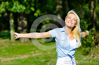 Pretty girl with her arms outstretched
