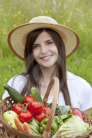 Free Pretty Girl Holding A Basket Of Vegetables Stock Photos - 19806583